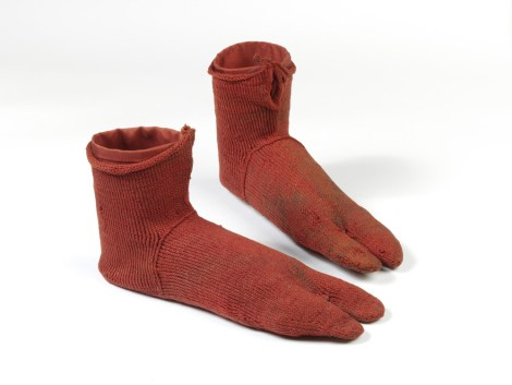 No mismatching on these socks! We never think of ancient Romano-Egyptians wearing socks, but here they are—one of the oldest surviving pair of socks, red wool beauties excavated from a Greek colony in Egypt and dating to about 250-420 CE. Photograph © Victoria and Albert Museum, London