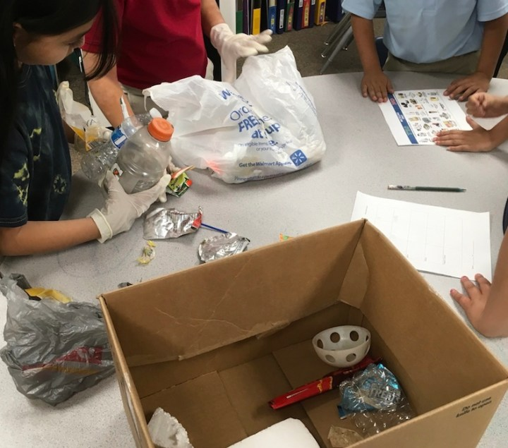 Students sorting trash