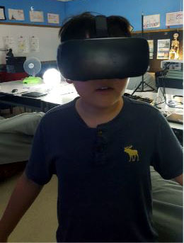 Student wearing a virtual reality headset