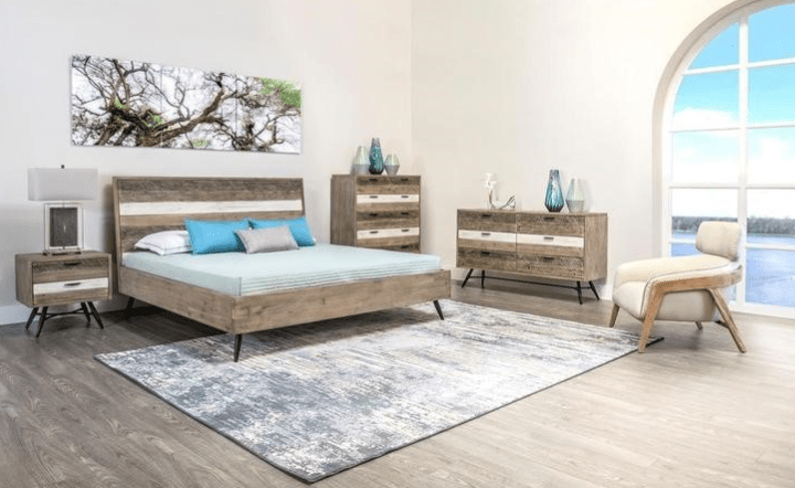 Natural bedroom set in lifestyle setting with cream chair and multicolor wall art by El Dorado Furniture