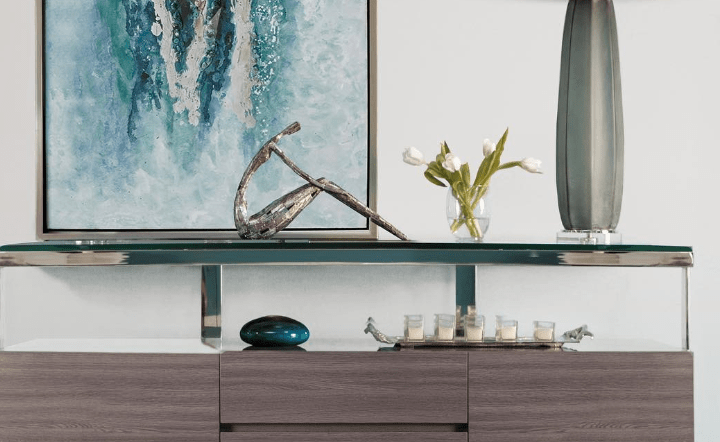 Gray cabinet, gray table lamp, blue wall art, and decorative accessories in lifestyle setting by El Dorado Furniture