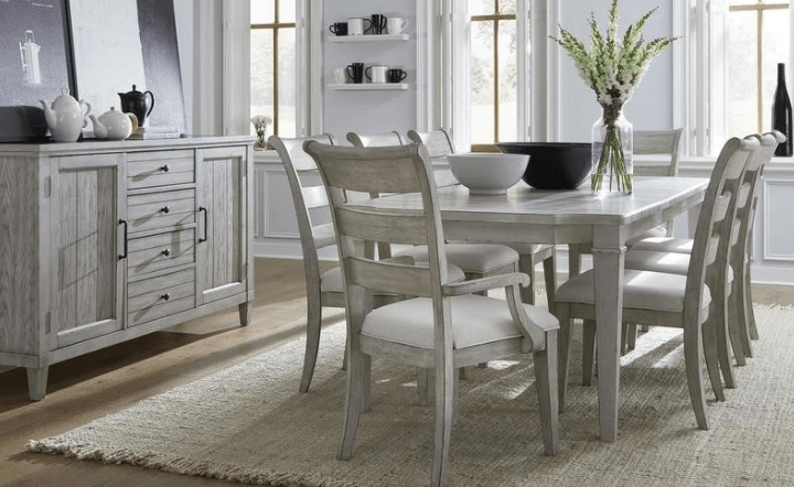 Natural white dining chairs, table, and credenza in lifestyle setting