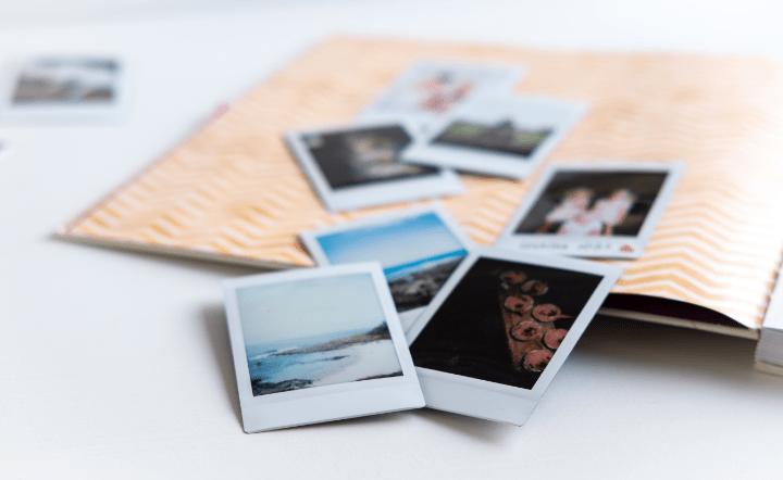 Close-up of photo book on white table