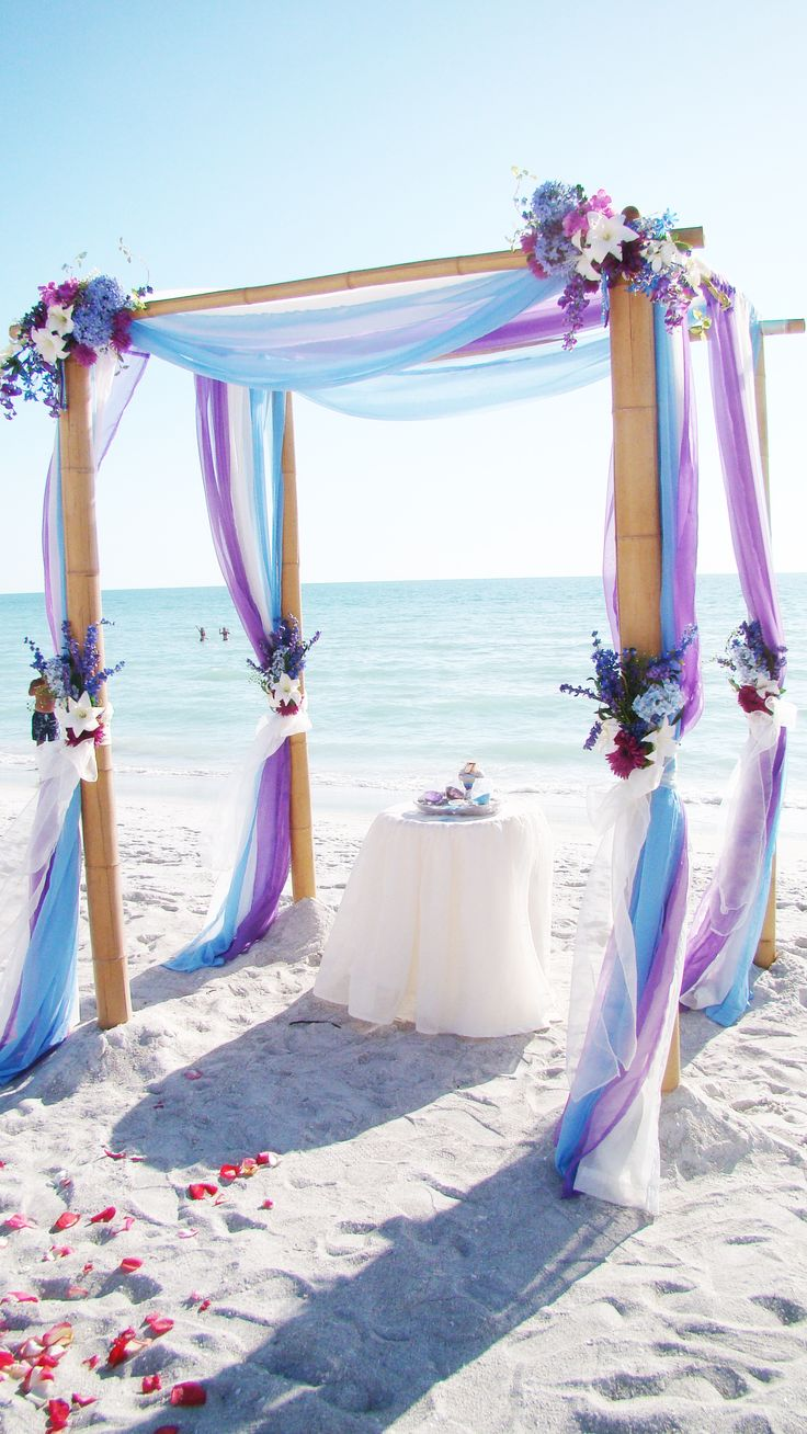 light-blue-and-purple-beach-wedding-arch