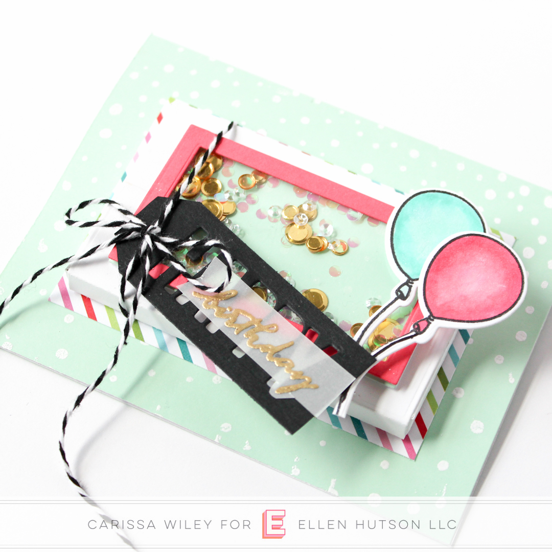 Close up of birthday themed Essentials by Ellen Parcel Box shaker