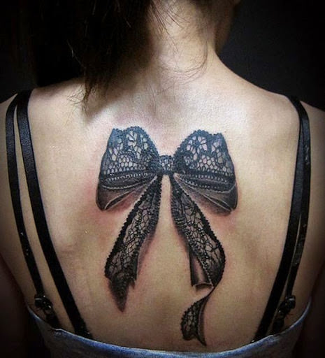 Bow tattoos for women on back.