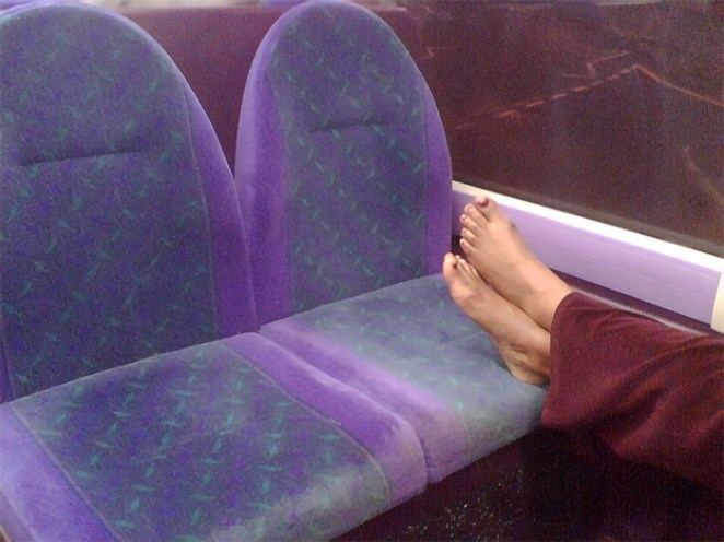 Putting Your Feet All Over Somebody Else's Space On Planes And Trains