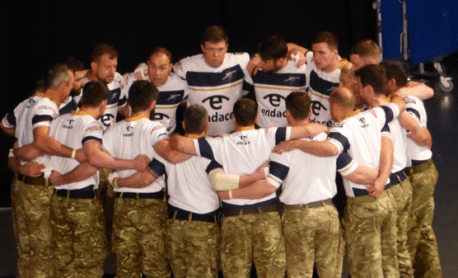 Royal Navy team huddles before the field gun competition