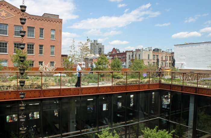 across-the-inner-courtyard-you-can-see-people-hanging-out-in-the-rooftop-garden