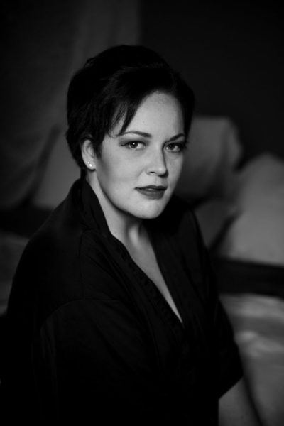 woman in black silk robe looking at camera regina boudoir photography session black and white