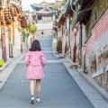 girl in pink coat in Bukchon neighbourhood in Seoul, South Korea