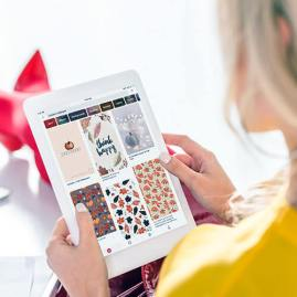 Woman Looking At Pinterest On Tablet