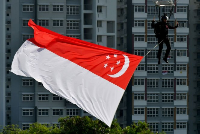A member of the Red Lions landing at the open field near Sengkang General Hospital during the NDP rehearsal on July 26, 2020.ST PHOTO: LIM YAOHUI