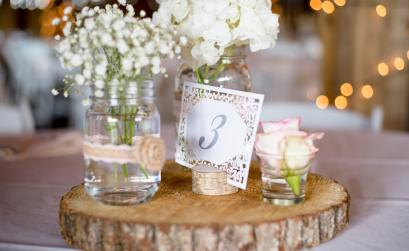 Flowers on Log Pedestals for Spring Centerpiece