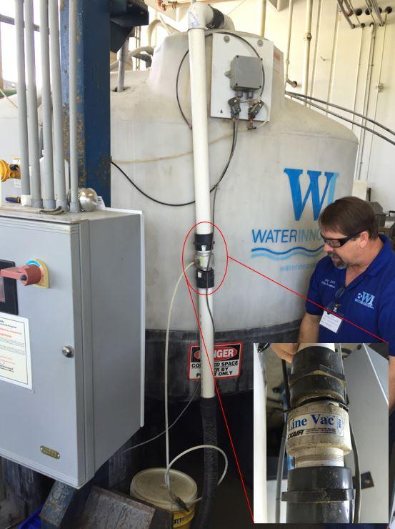 "Model 140200 2"" NPT Aluminum Threaded Line Vac moves bentonite clay into water recycling tank."