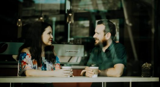 two people chatting in coffee shop