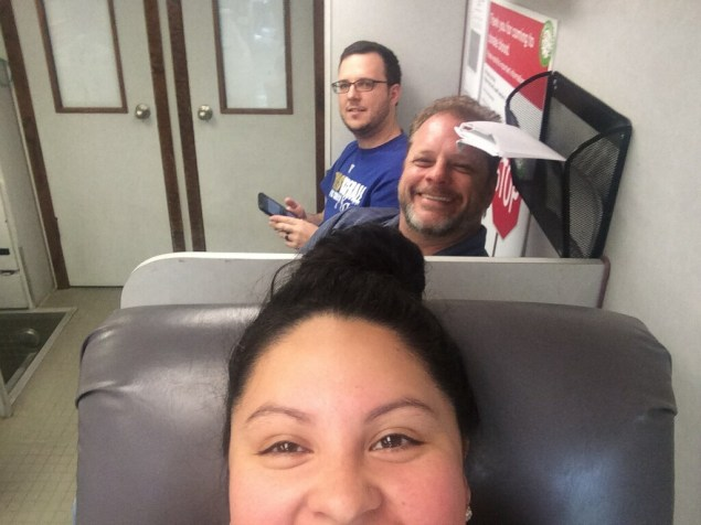 Left to right: Kasey G. and Brian S. wait their turn while Leslie C. gives blood.