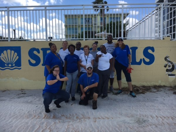Sea Shells Beach Club staff in front of the resort in Daytona Beach, Florida