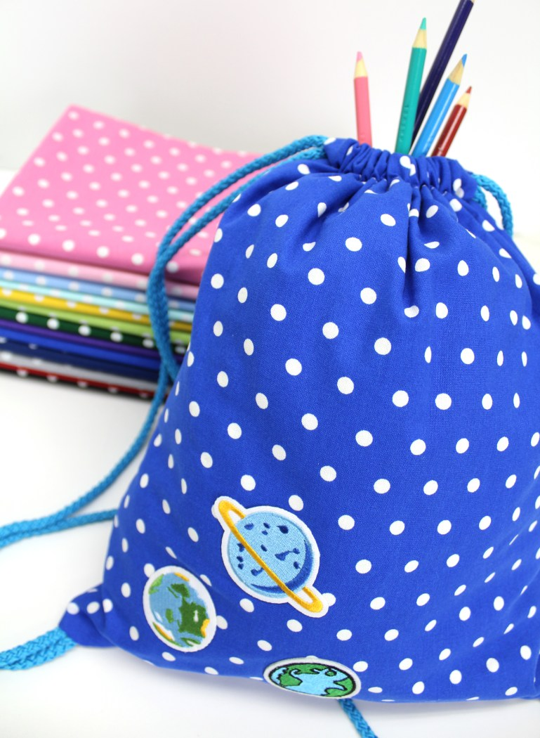 photo of a drawstring backpack made using the .5cm dot in colour royal