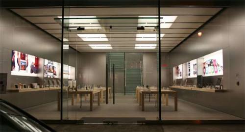 The empty Apple Store at night