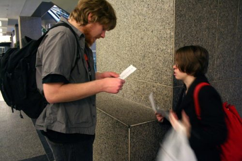 Alex and Kristin check their lists during February's scavenger hunt