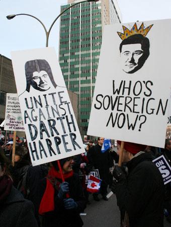 Signs demonize Prime Minister Stephen Harper