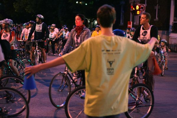 At St. Joseph and Garnier, volunteers fed cyclists from three directions toward the start line.