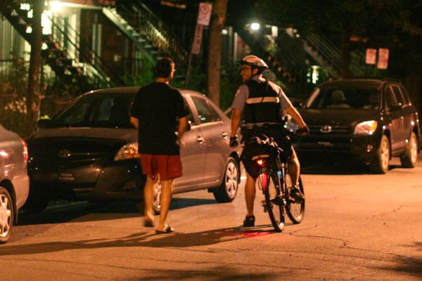 A police officer on his bike leaves the scene without giving tickets or ensuring the vehicles are moved.