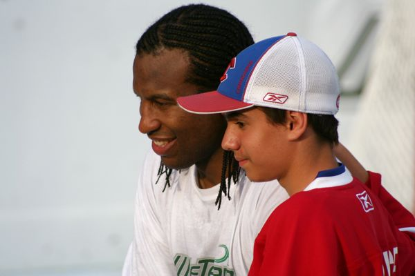 Smiling after his gajillionth picture with a young fan