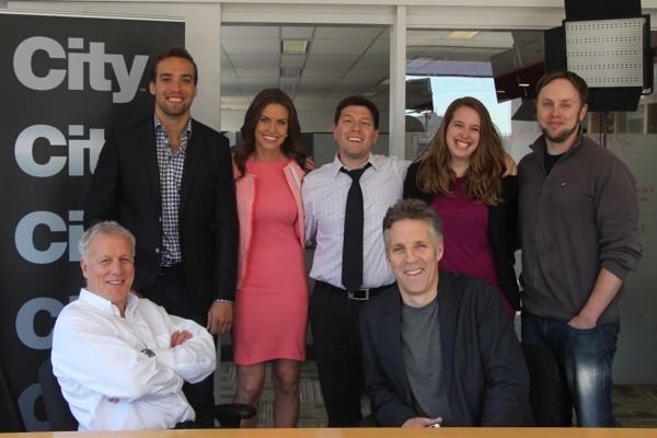 City Montreal staff. Seated: Montreal Connected Executive Producer George Athans (left), City Montreal Executive Producer Bob Babinski (right). Standing, from left: Montreal Connected hosts Wilder  Weir and Alyson Lozoff, New Media Producer Elias Makos, Montreal Connected Associate Producer Kelly Greig, Montreal Connected Director of Photography and editor Ian Graham
