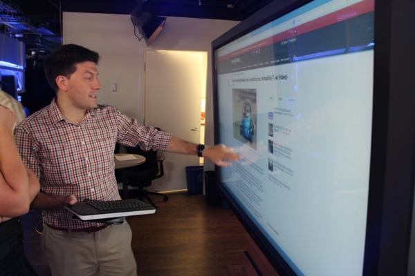Elias Makos demonstrates the 65-inch touchscreen he'll be using to show what's trending online.
