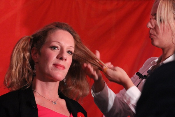 Christine Long's hair is made into ponytails for collection.