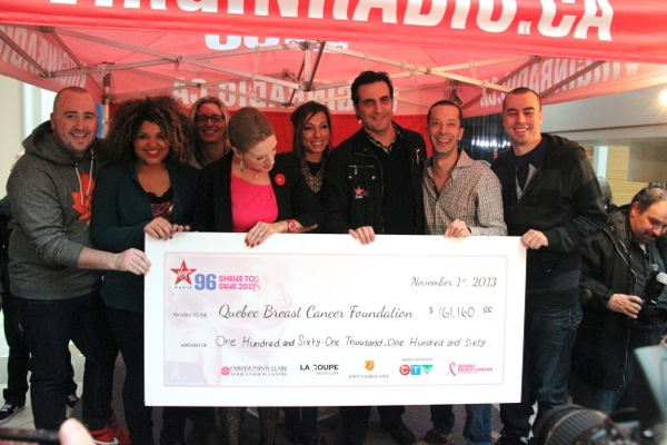The Virgin Radio crew pull up a giant cheque for $161,160.