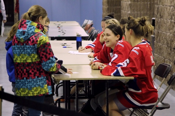 Montreal Stars players sign autographs for fans after each home game.