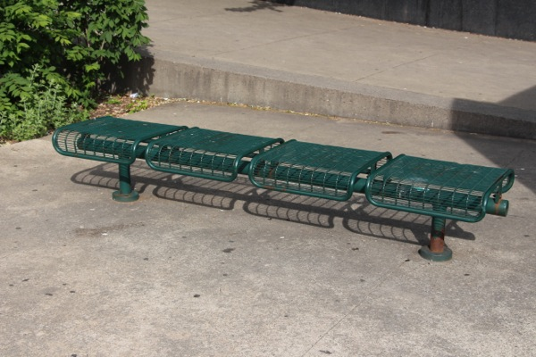 A bench at Émilie Gamelin Park pivots at the centre, designed to throw anyone who tries to lie on it to the ground.
