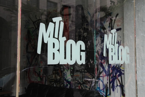 MTL Blog has its logo proudly stencilled on the windows of its storefront office on St-Laurent Blvd. on the Plateau