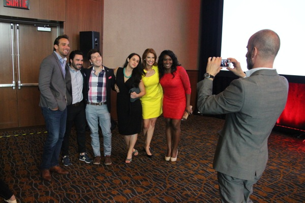 Jeffrey Feldman, right, takes a picture of the Breakfast Television cast at a fall upfront event in June 2014.