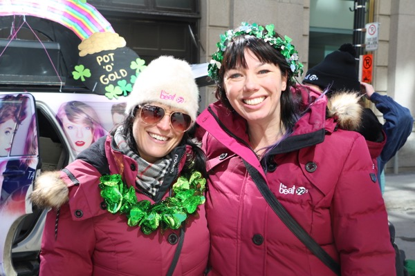 Sarah Bartok, left, and Kim Sullivan representing The Beat at this year's St. Patrick's Parade on March 20. The station has since told both of them it no longer requires their services.