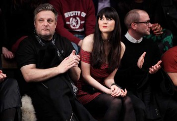 LONDON, ENGLAND - JANUARY 07: (L to R) Rankin, Lilah Parsons and guest sit in the front row during the Superdry AW14 catwalk event as part of London Collections: Men at The Old Sorting Office on January 7, 2014 in London, England. (Photo by David M. Benett/Getty Images for Superdry) *** Local Caption *** Rankin; Lilah Parsons