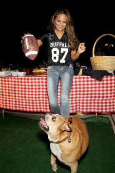 """Chrissy Teigen hosts a Buffalo David Bitton """"tailgate party"""" for the Jets/Patriots game at Lord & Taylor"""