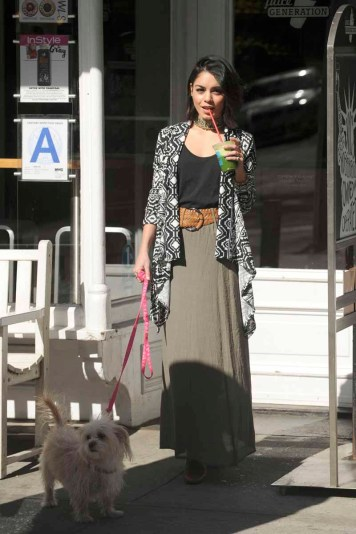 -New York, NY - 04/27/2015 - Vanessa Hudgens goes for an afternoon juice run with her dog. She looks great in her little black top, choker necklace and Bongo belted crepe maxi skirt and Bong tribal print waterfall cardigan. -PICTURED: Vanessa Hudgens -PHOTO by: Michael Simon/startraksphoto.com -MS_261104 Editorial - Rights Managed Image - Please contact www.startraksphoto.com for licensing fee Startraks Photo New York, NY For licensing please call 212-414-9464 or email sales@startraksphoto.com Startraks Photo reserves the right to pursue unauthorized users of this image. If you violate our intellectual property you may be liable for actual damages, loss of income, and profits you derive from the use of this image, and where appropriate, the cost of collection and/or statutory damages.