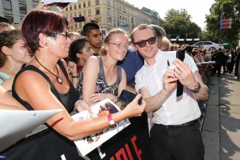 VIENNA, AUSTRIA - JULY 23: (EDITORS NOTE: This image has been digitally manipulated) Simon Pegg poses with fans during the world premiere of 'Mission: Impossible - Rogue Nation' at the Opera House (Wiener Staatsoper) on July 23, 2015 in Vienna, Austria. (Photo by Gisela Schober/Getty Images for Paramount Pictures International)