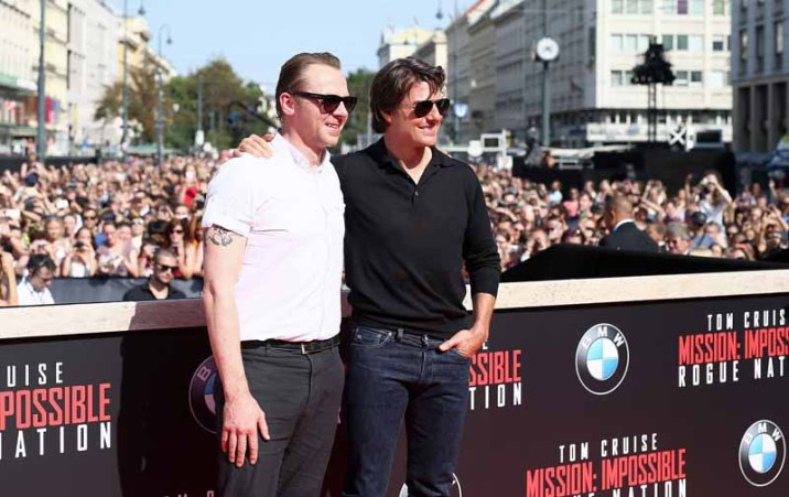 VIENNA, AUSTRIA - JULY 23: (EDITORS NOTE: This image has been digitally manipulated) Simon Pegg (L) and Tom Cruise attend the world premiere of 'Mission: Impossible - Rogue Nation' at the Opera House (Wiener Staatsoper) on July 23, 2015 in Vienna, Austria. (Photo by Andreas Rentz/Getty Images for Paramount Pictures International)