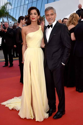 """CANNES, FRANCE - MAY 12: Actor George Clooney and his wife Amal Clooney attend the """"Money Monster"""" premiere during the 69th annual Cannes Film Festival at the Palais des Festivals on May 12, 2016 in Cannes, France. (Photo by Clemens Bilan/Getty Images)"""