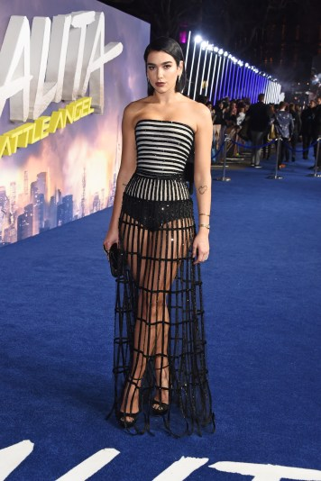Dua Lipa who performed the official song for the movie slayed the blue carpet with the fierce style of a Giorgio Armani Privé voile bustier dress with ribbons embroidered with black crystals. (Photo courtesy of Giorgio Armani)
