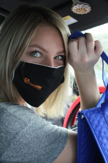 female fetchme driver wears mask for delivery orders