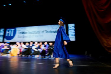 student walks across the stage