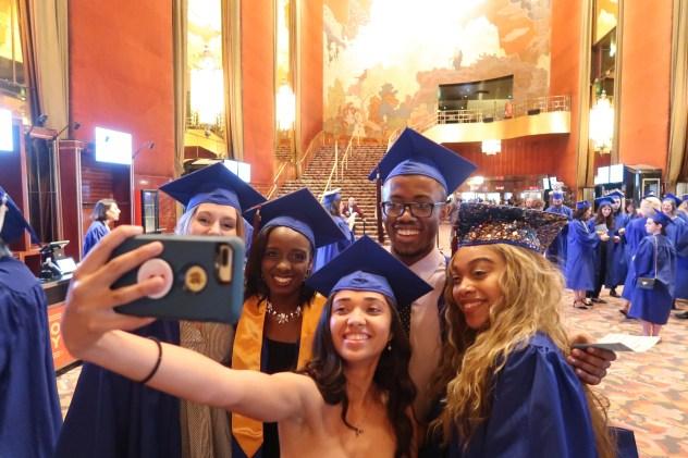 five students taking a selfie