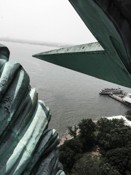 close photograph of statue of liberty's crown
