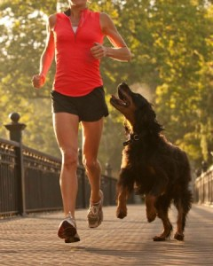 woman-running-with-dog-450